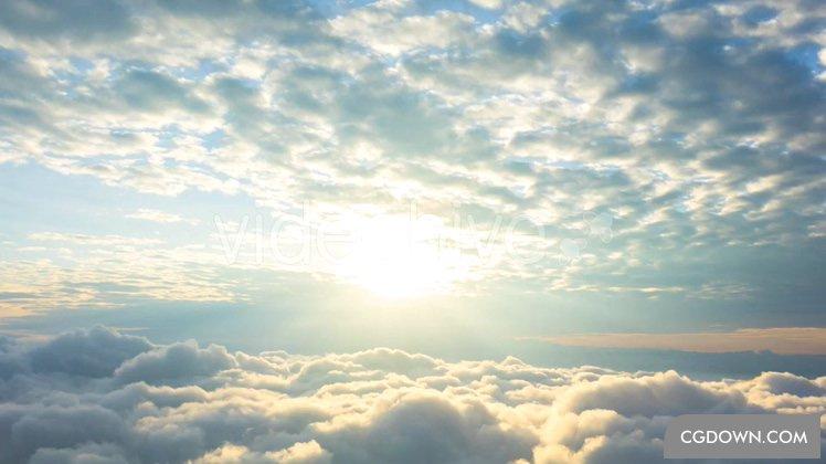 云层上端云海太阳普照背景高清视频素材