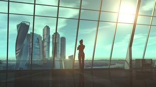 女商人在俯视商业中心的办公室视频素材影视模板